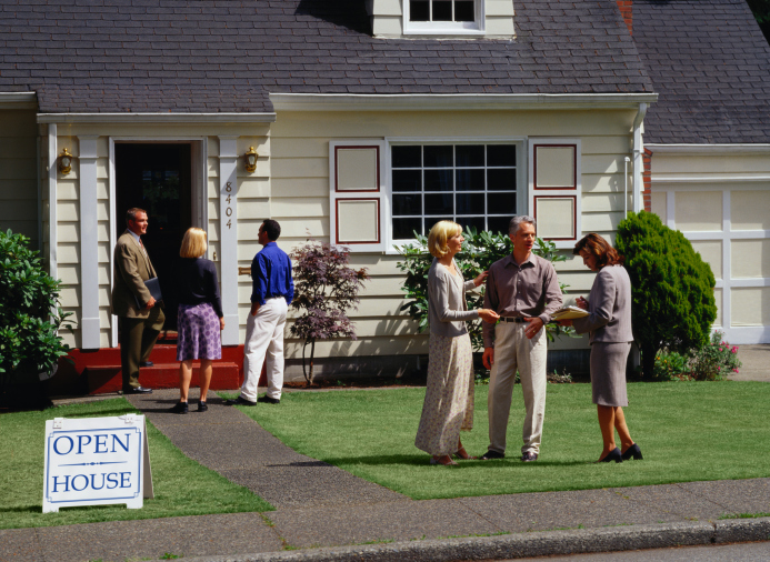Image of couples and Real Estate Agents at an Open House