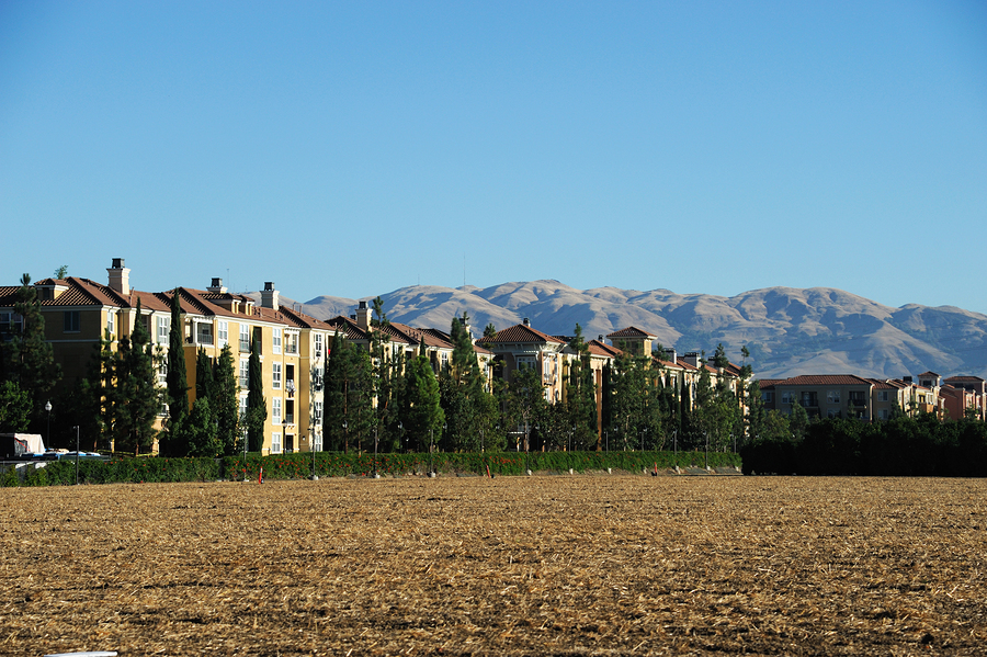 apartment buildings, open land for future construction in San Jose, CA